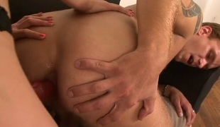 Brunette copulates guy strapon