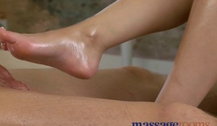 Foot rub and oil sex with breasty masseuse