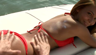 Hawt young red head is having passionate sex on a yacht