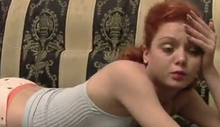 Redhead sexy hotty is already naked and playful on the daybed