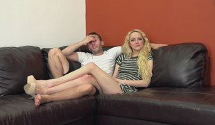 Divine-looking blond girl is happy to have sex on the couch