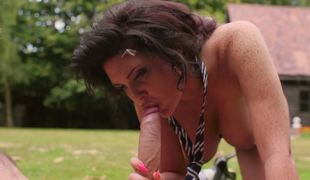 A brunette hair is out in the yard, naked, getting rammed by a dude