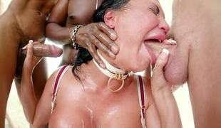 Busty hottie is screwed in mouth by a well-hung gang