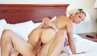 Twenty one year old blonde is on the bed with a guy