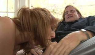 Topless redhead Rose Red with sweet bumpers gives head to an aged guy. Lengthy haired guy Evan Stone receives his rock hard dick polished with her soft lips. Nasty Rose Red blows like a champ