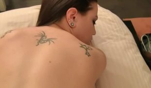 Petite tits brunette is getting her tattooed body loved on the bed