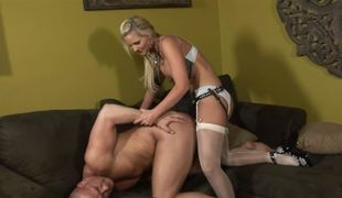 A blonde dominatrix permeates her slave with her strap on