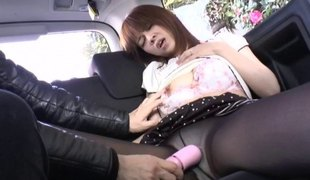 Oriental cowgirl pleasured with nice toy in the car close up shoot