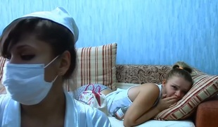 Nurse with large bust does injection