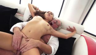 A curly long haired minx is feeling a old man inside her soaked pussy