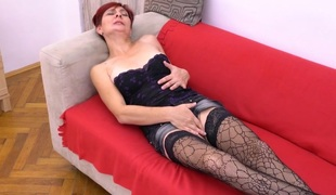 Sexually excited aged lady masturbating on her bed