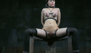 White whore handcuffed to the post in sitting position