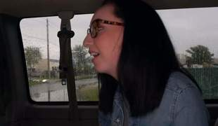 Black haired amateur Scarlett with glasses is fine at giving handjob. She strokes fortunate guys dick with both hands in the backseat on Bang Bus. Watch her play with his worm
