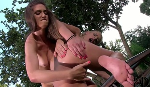 Chelsey Lanette touches her knockers in a playful manner