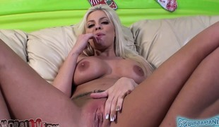 Stacked beauty Britney Amber toys her juicy peach and fucks a long pole