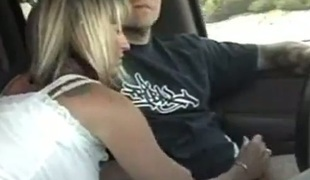 Lustful blonde MILF stroking uncle's dick while he's driving