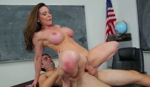 A milf teacher is teasing her student with her stripped flesh