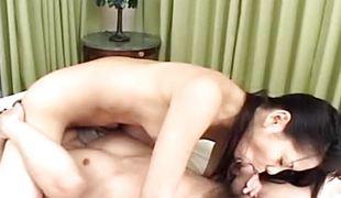 Asian brunette slavers over this stiff cock