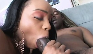 Voluptuous dark skinned beauty likes to suck and fuck a huge dark knob