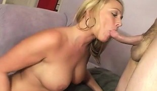 Oiled up blonde with big bazookas eats his shlong and acquires her shaved cunt pounded
