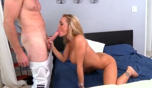 Blonde with giant boobs with the addition of bald bush warms dude up with her hands with the addition of takes his worm