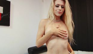 A blonde removes her clothing and then she sucks a big dildo