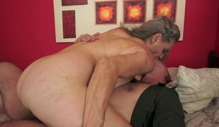 A granny with saggy bumpers and a hairy pussy is fucked really hard