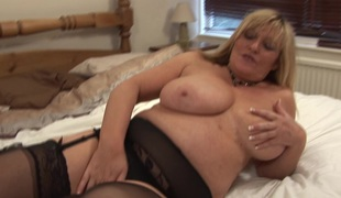 Chubby MILF with large tits Alisha loves fingering her wet snatch