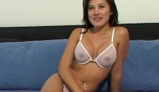 Bombastic playgirl from Asia takes the purple toy and stabs her vagina