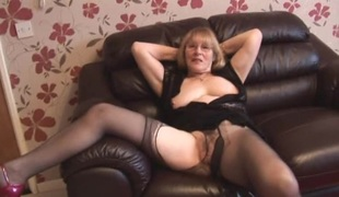 Stylish granny in pantyhose tease
